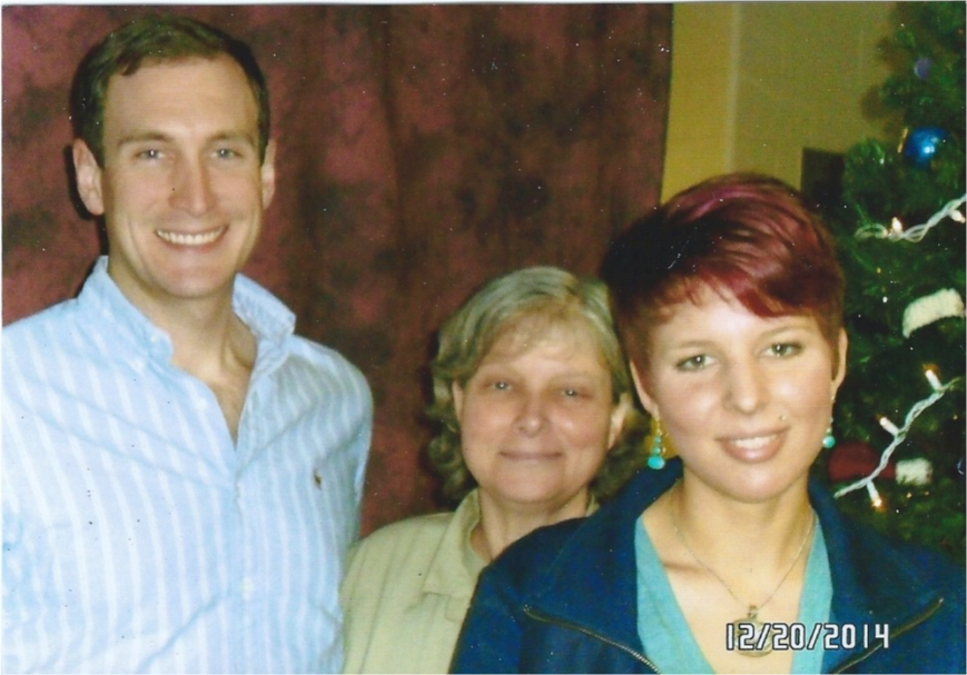 A photo of Marius with his two children, Andrei and Arianna.